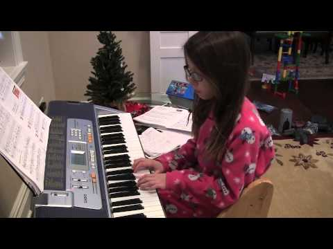 The kids play christmas songs on piano