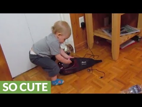 Baby has a fit after vacuum turns on