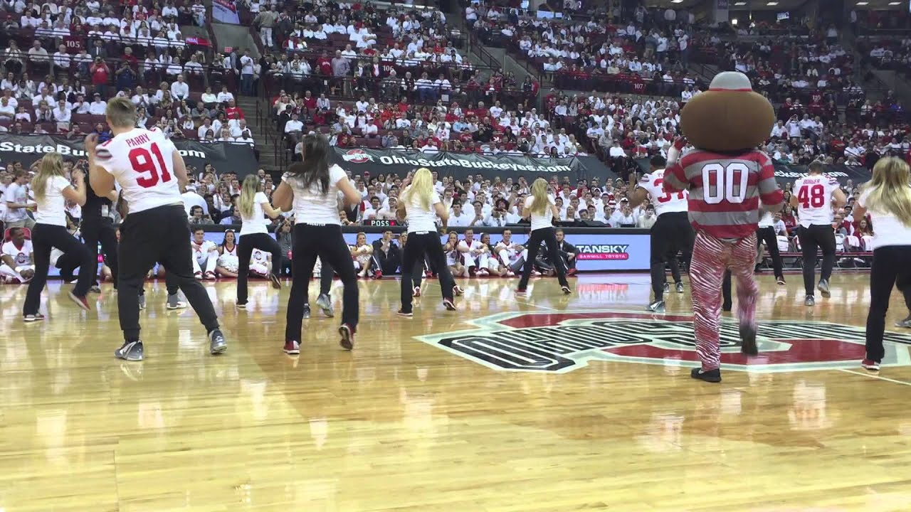 ohio state football players dance at a basketball game