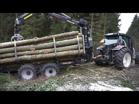 Logging with new Valtra A124 forestry tractor, fully loaded Palms trailer and crane 7,86