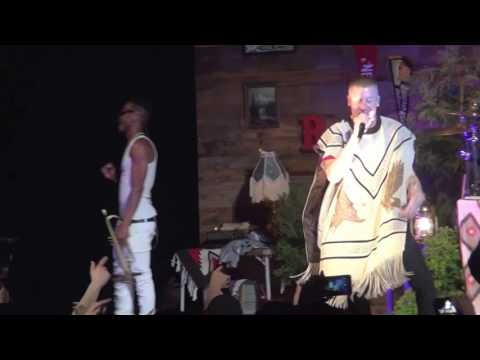 "Macklemore singing ""Thrift Shop,"" at the 7th Street Theatre in Hoquiam, Washington."