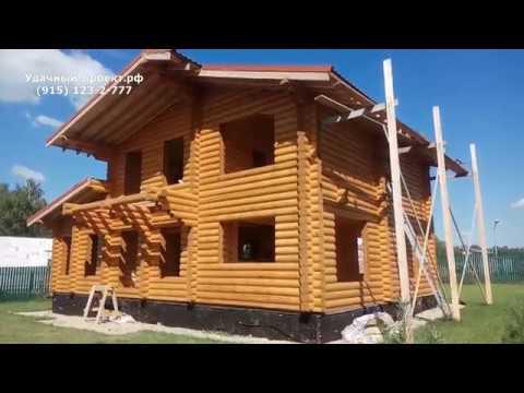Покраска деревянного дома из бревна