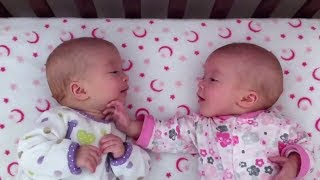 identical twin girls engage in deep conversation