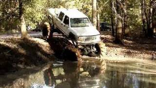 GIANT LIFTED BIG BLOCK CHEVY 4X4 on TRACTOR TIRES GOES DEEEEEEP!!