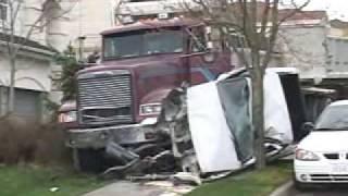 COQUITLAM DUMP TRUCK CRASH HITS PARKED CAR ON PANARAMA DR.wmv