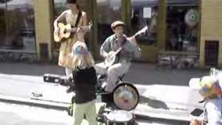 the tallboys string band playing at ballard farmers market
