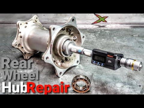 Repair of damaged motorcycle rear wheel hub.