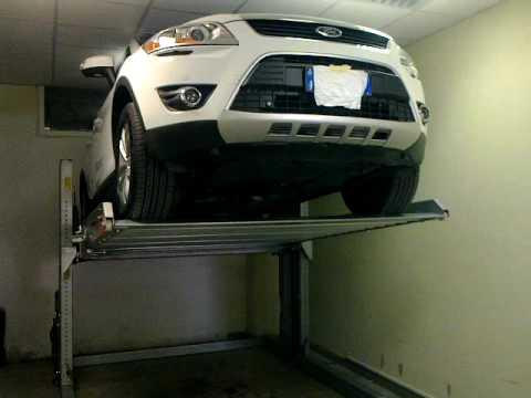 Sollevatore per auto a due colonne youtube for Due piani un garage per auto