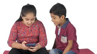 Happy young children busy using a smartphone and surfing new things on the internet