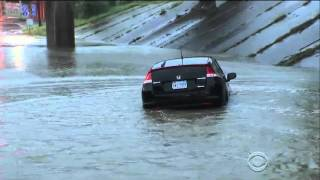 man drives into flooded underpass