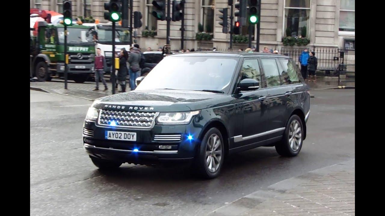 Metropolitan Police Seg Escorting An Unmarked Range Rover