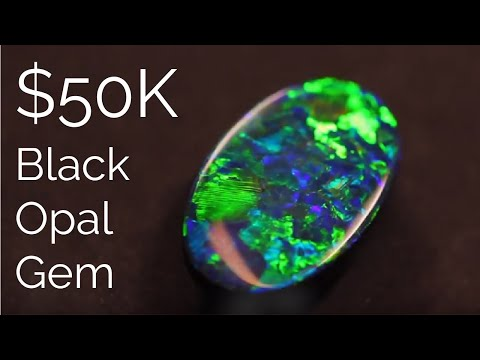 See a top $50k gem black opal being cut and polished