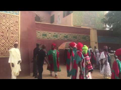 Emir of kano muhammadu sanusi ii, coming out of the palace.
