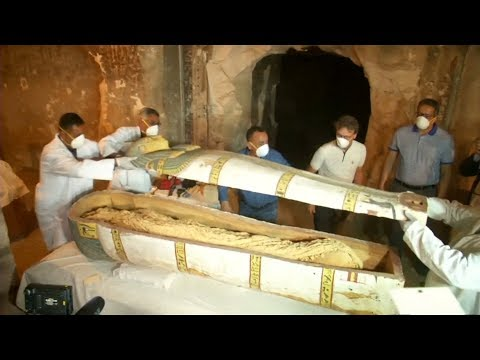 Archaeologists unveil ancient Luxor tomb, open closed coffin