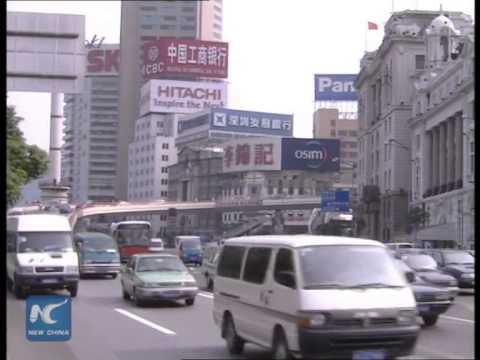 China lowers RRR, interest rates after market slump