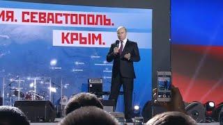 Vladimir Putin campaigns in disputed territory of Crimea