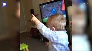 Adorable little football fan yells 'goal' as ball is kicked into net