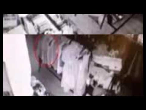 Spooky CCTV footage shows 'ghostly' figure drift past clothing rack in 130-year-old antiques store