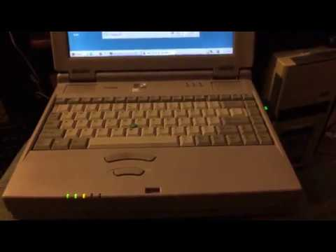 Browsing The Internet And Chat Rooms Using A Laptop From 1998 With Windows 98.