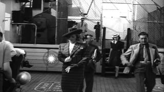 Acting and singing star Marlene Dietrich poses for photographers aboard the Queen...HD Stock Footage