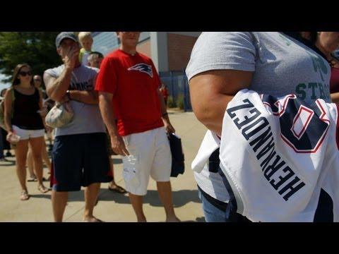 Patriots fans exchange Aaron Hernandez jersey