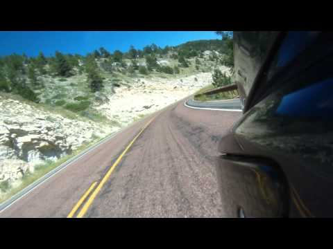 Riding east on Highway 14 through the Bighorn Mountains, Wyoming, USA. BMW K1200LT