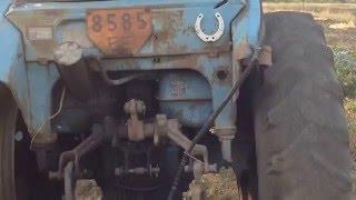 трактор после минометного обстрела