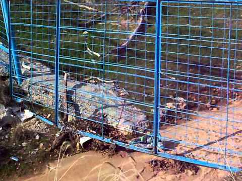 fencing across a creek or water crossing