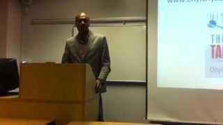 Onyi Anyado delivering a Keynote Presentation to students at South Bank University.