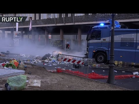 Rome police disperse rioting migrants with water cannons