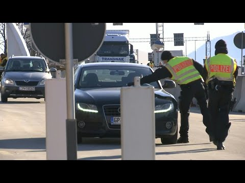 Coronavirus: German Police Officers Control Cars At Border With Austria | AFP