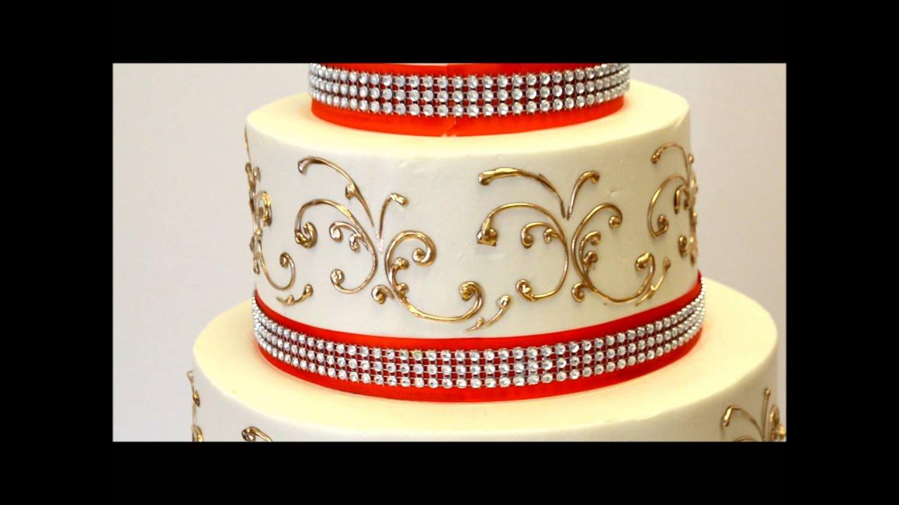 Three Tier Wedding Cake With Gold And Orange Ribbon