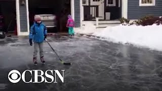 Amid deep freeze, kids in Boston ice skate on driveway