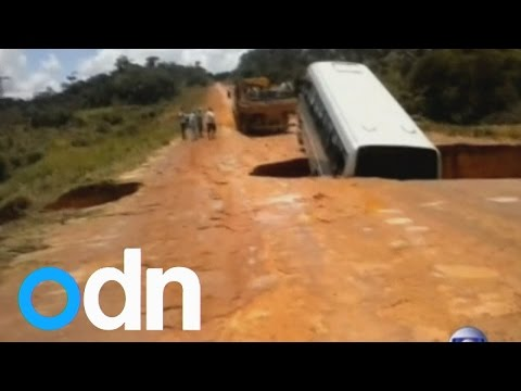 Bus falls through massive crater in Brazil and floats away