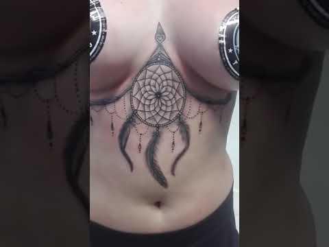 dreamcatcher feathers lace  underboob sternum tattoo robert costea tattoo art bucharest