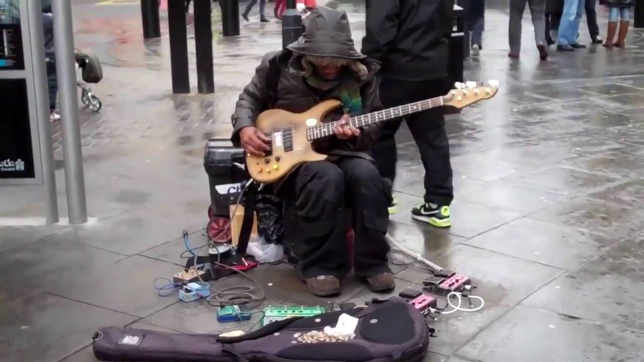 An asshole playing a guitar