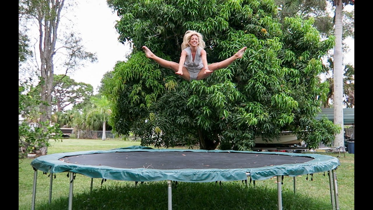 Naked women on trampoline