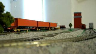 slow run of my mth ho scale sd70ace pulling a modern freight manifest