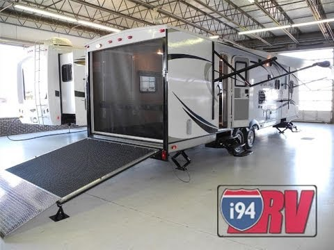 2014 sporttrek 300vth toy hauler travel trailer venture rv for Rv trailer with garage