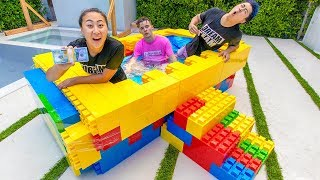 WE MADE A LEGO HOT TUB AND IT WORKED!! LAST ONE TO LEAVE WINS $10000!! GET YOUR MERCH AT https://www.likelizzy.com ♥   Todays challenge ...