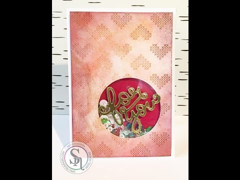 Add shimmer to your embossed backgrounds using AquaTints