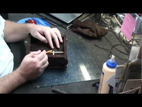 gluing the leather inside my wooden jewelry box.