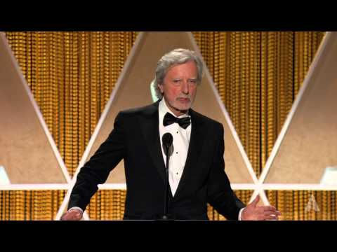 Philip Kaufman honors JeanClaude Carrière at the 2014 Governors Awards