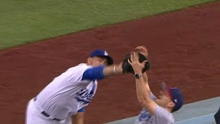 COL@LAD: Gonzalez and fan reach for the same ball