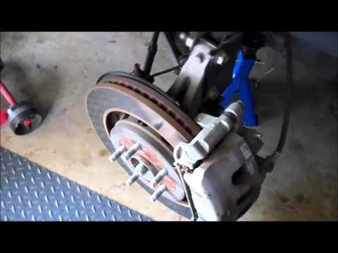 2014 Ford Explorer Sport Front Brake Pads Replacement - YouTube