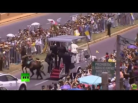 Download Youtube: Popemobile grinds to a halt as Pontiff aids fallen police woman