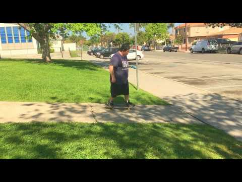 Big Man skateboard does no comply body varial on bank at William Green Elementary School