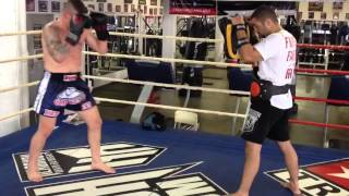 John Wayne Parr smashing Pads at Tristar with Coach Firas Zahabi