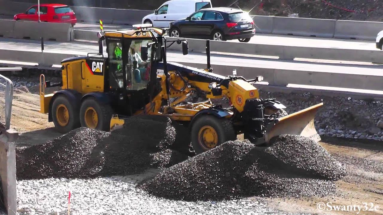 Volvo Snow Plow >> CAT 140M Spreading Out Rocks - YouTube