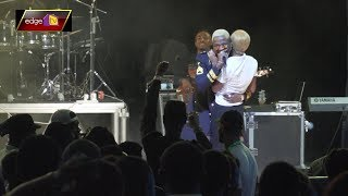 Kizz Dainel Brings Out Female Fan As He Romance Her Live On Stage